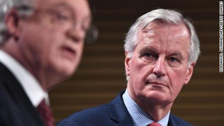 "The EU's chief negotiator Michel Barnier, right, says it's vital to agree Britain's ""divorce bill"" soon if talks with David Davis, left, are to move forward."