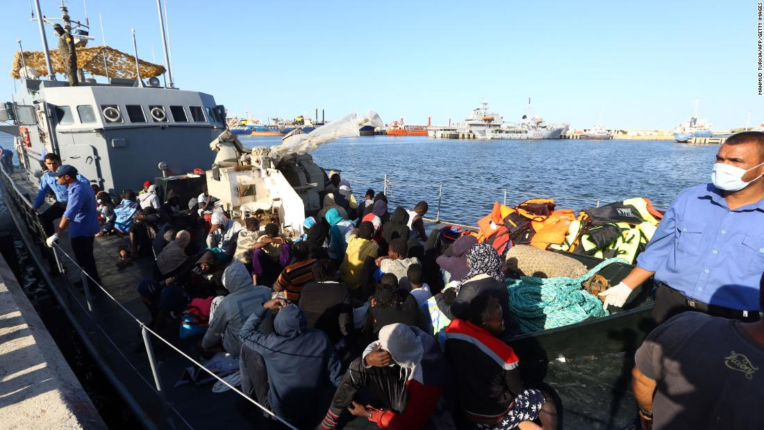 Migrants rescued from the Mediterranean arrive at a naval base in Tripoli in October.