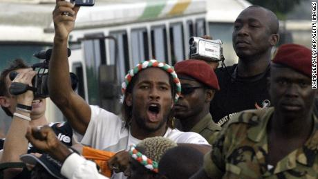 Abidjan, IVORY COAST:  Drogba Didier jubilates aboard a military vehicle at Felix Houphouet Boigny airport 09 October 2005, arriving with the victorious Ivorian national team at Abidjan after Ivory Coast qualified for the CAN-MONDIALE 2006 world football championship. PHOTO AFP/KAMPBEL.  (Photo credit should read KAMPBEL/AFP/Getty Images)