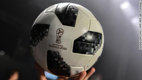 "A participant holds the official match ball for the 2018 World Cup football tournament, named ""Telstar 18"", during its unveiling ceremony in Moscow on November 9, 2017. / AFP PHOTO / Mladen ANTONOV        (Photo credit should read MLADEN ANTONOV/AFP/Getty Images)"