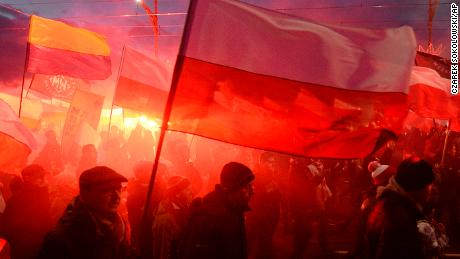 Demonstrators burn flares and wave Polish flags during the annual march to commemorate Poland's National Independence Day in Warsaw, Saturday, Nov. 11, 2017.  Thousands of nationalists marched in Warsaw on Poland's Independence Day holiday, taking part in an event that was organized by far-right groups. (AP Photo/Czarek Sokolowski)