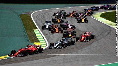 SAO PAULO, BRAZIL - NOVEMBER 12: Sebastian Vettel of Germany driving the (5) Scuderia Ferrari SF70H leads Valtteri Bottas driving the (77) Mercedes AMG Petronas F1 Team Mercedes F1 WO8 into turn two at the start during the Formula One Grand Prix of Brazil at Autodromo Jose Carlos Pace on November 12, 2017 in Sao Paulo, Brazil.  (Photo by Dan Istitene/Getty Images)