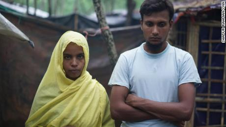 Hasina, left, and her husband Shahidul on October 8. They say soldiers burned their one-year-old daughter alive.