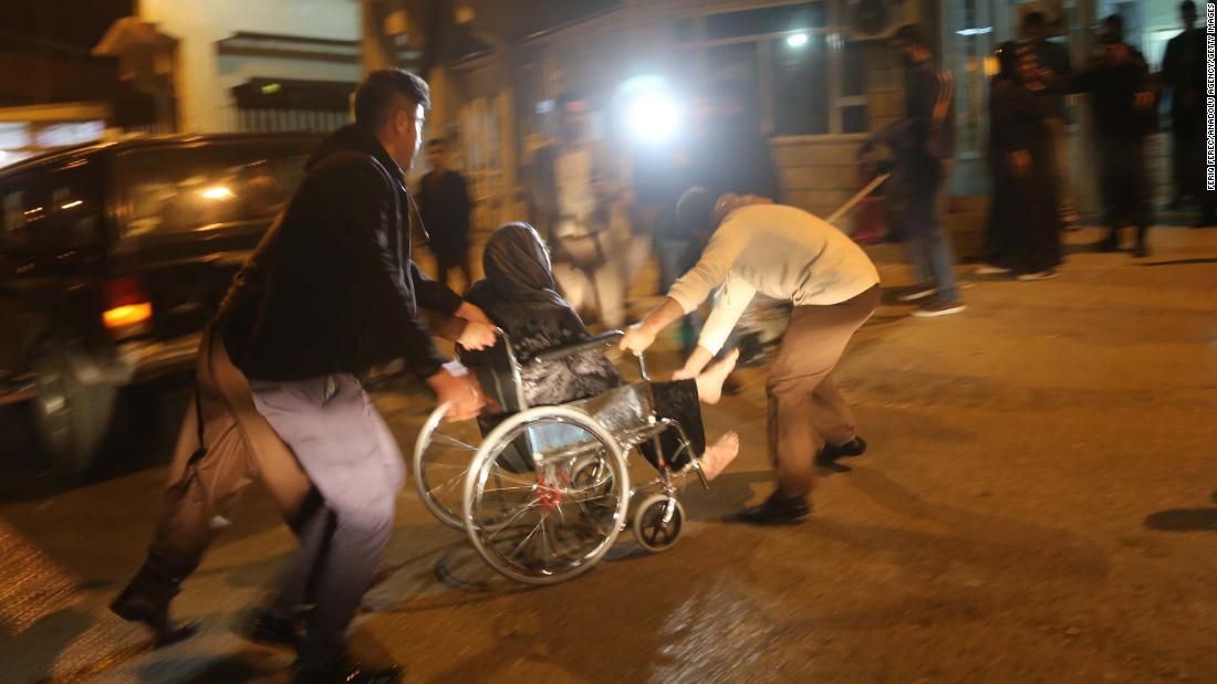 A wounded person is rushed to a hospital in Iraq's Sulaimaniya province on November 12.<br />
