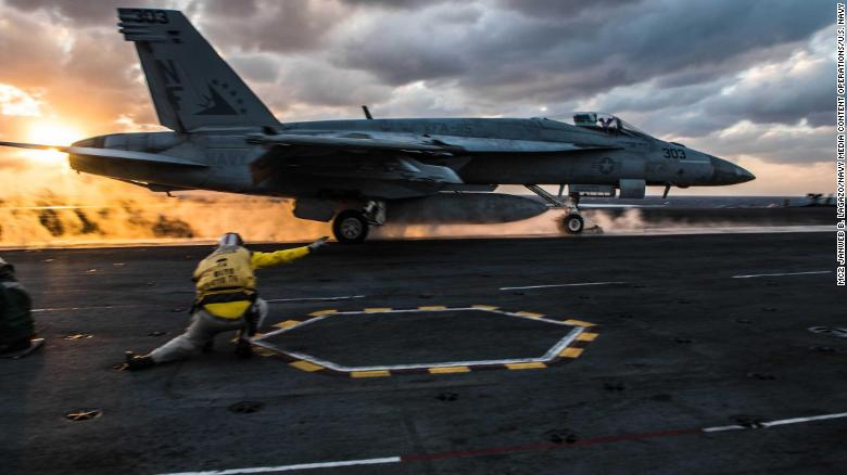 An F/A-18E Super Hornet launches from the flight deck of the aircraft carrier USS Ronald Reagan.