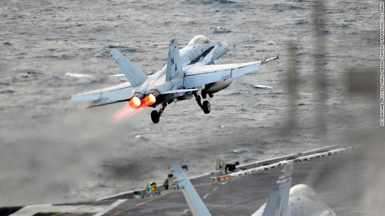 An F/A-18E Super Hornet launches from the flight deck of the aircraft carrier USS Theodore Roosevelt.