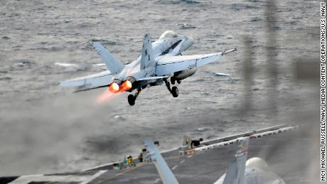 An F/A-18E Super Hornet launches from the flight deck of the USS Theodore Roosevelt.