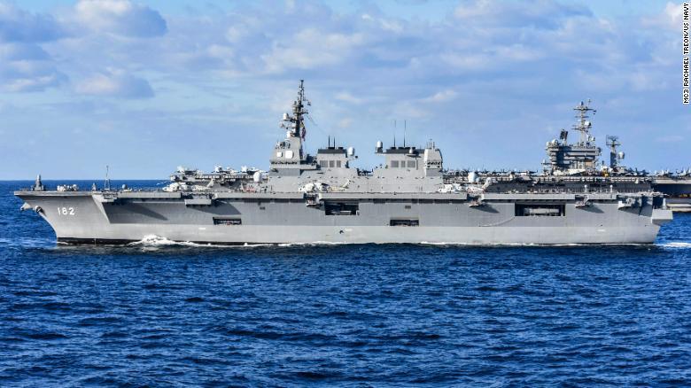 Japan's Maritime Self-Defense Force helicopter destroyer JS Ise sails alongside the aircraft carrier USS Nimitz .