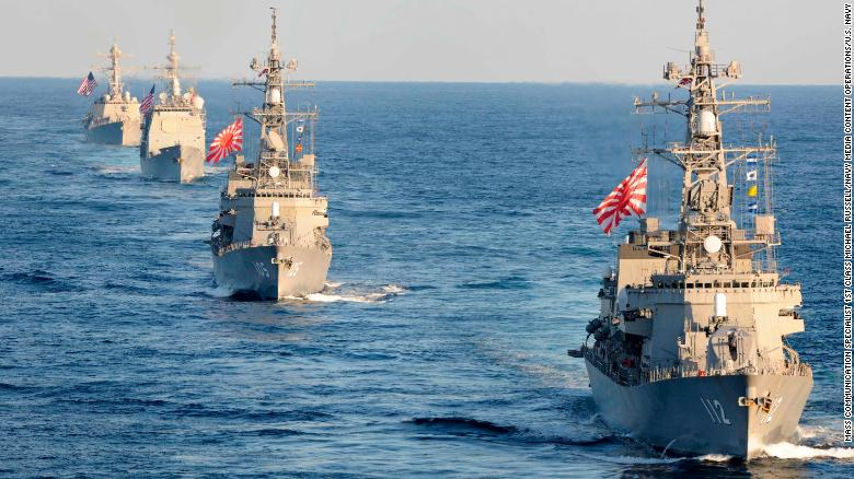 The Japanese Maritime Self-Defense Force Takanami-class destroyer JS Makinami, front, and the Murasame-class destroyer JS Inazuma, second, the guided-missile cruiser USS Bunker Hill, third, and the guided-missile destroyer USS Preble, rear, transit the western Pacific Ocean.
