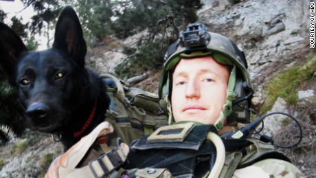 "U.S. Army Ranger Hunter Donovan and his dog, Nuke, in a photo featured in the HBO documentary, ""War Dogs."""