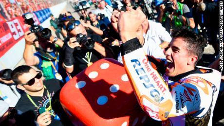 Marquez celebrates his sixth overall world title in Valencia.