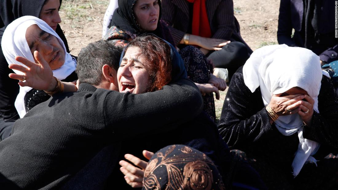 People cry near the wreckage of their home in Sarpol-e Zahab on November 13.