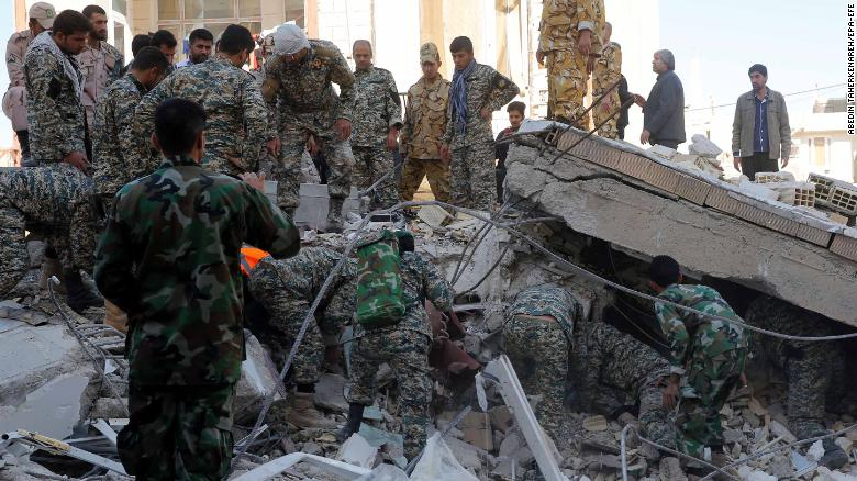 Iranian rescuers search the wreckage of a building in the city of Pole-Zahab in Kermanshah Province, Iran.