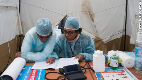 Doctors and nurses from The Ministry of Health and officers of the Malagasy Red Cross staff a health care checkpoint in Antananarivo.