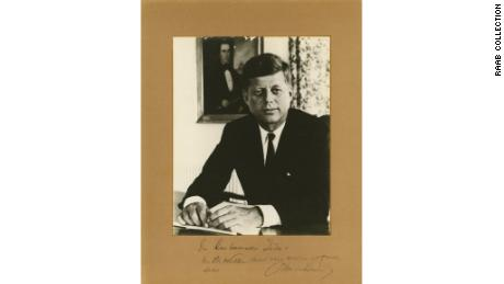 This photo is believed to be the last thing President Kennedy signed in the Oval Office.
