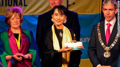 "Suu Kyi holds a birthday cake at the ceremony where she received the ""Freedom of the City of Dublin"" award in Dublin in June 2012."