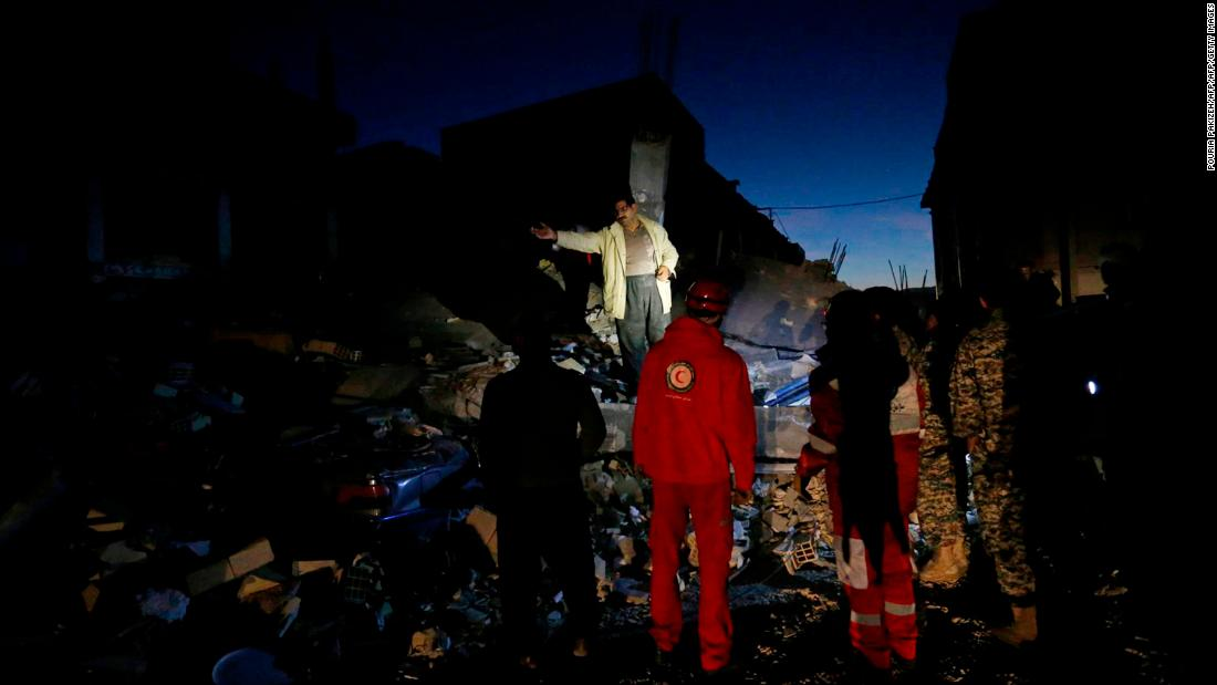 Rescue crews search through the rubble in Sarpol-e Zahab on November 13.