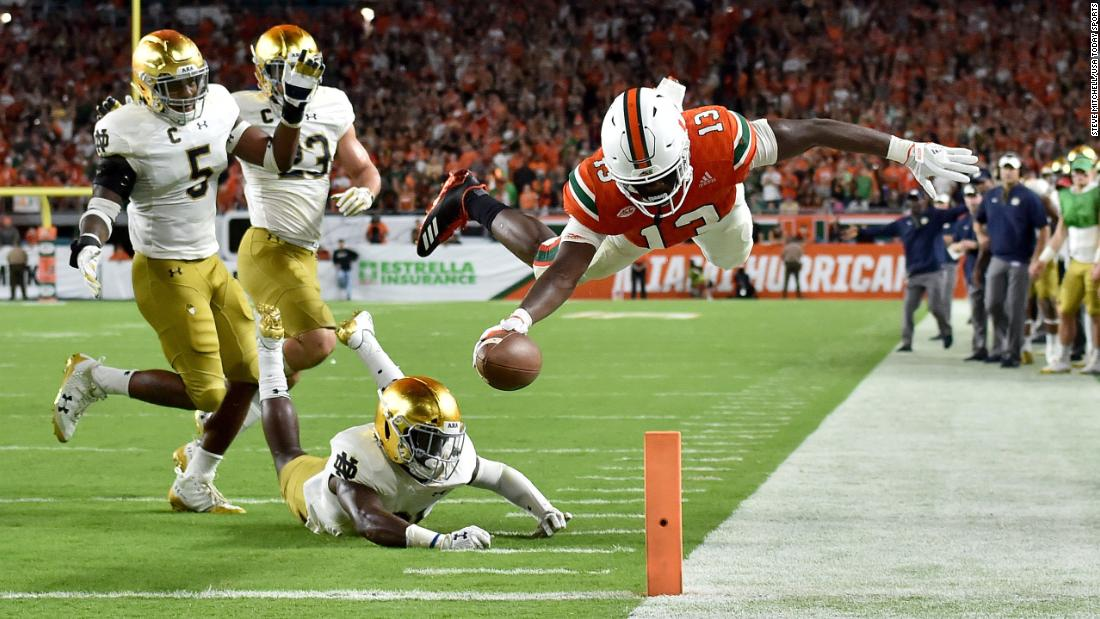Miami wide receiver DeeJay Dallas dives over the goal line to score a second-half touchdown against Notre Dame on Saturday, November 11. Miami trounced its rival 41-8 to stay undefeated this season (9-0).