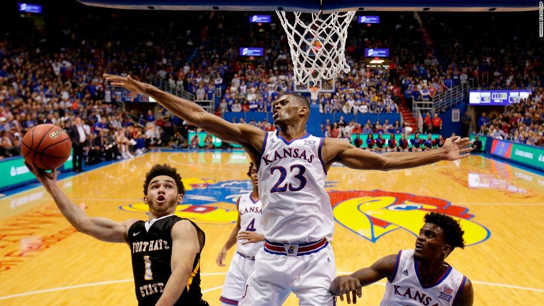 Kansas' Billy Preston blocks a shot by Fort Hays State's Aaron Nicholson during a college basketball game in Lawrence, Kansas, on Tuesday, November 7. Kansas won the exhibition 86-57 and entered the regular season as a top-5 team.