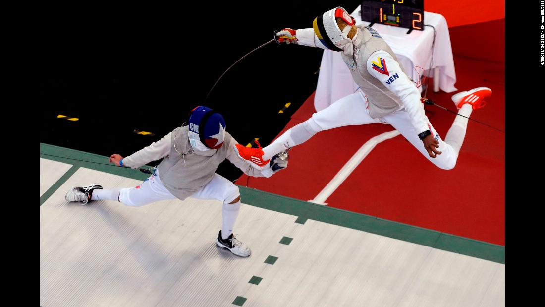 Venezuelan fencer Antonio Leal, right, takes on Chile's Ruben Silva at the Bolivarian Games on Sunday, November 12.