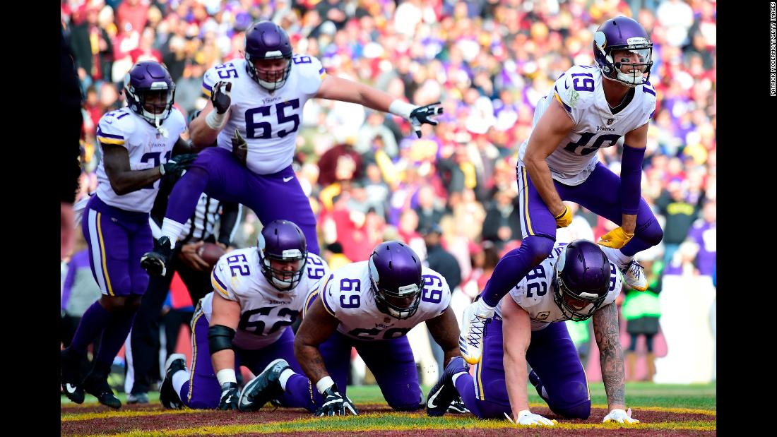 The Minnesota Vikings play leapfrog as they celebrate a touchdown by Adam Thielen, right, on Sunday, November 12. Thielen had 166 receiving yards in the Vikings' 38-30 victory over Washington.