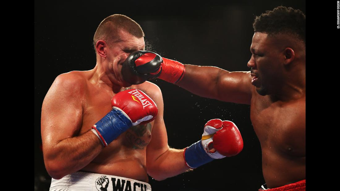 Jarrell Miller punches Mariusz Wach during a heavyweight bout in Uniondale, New York, on Saturday, November 11. Miller stopped Wach in the ninth round to remain undefeated.<br />