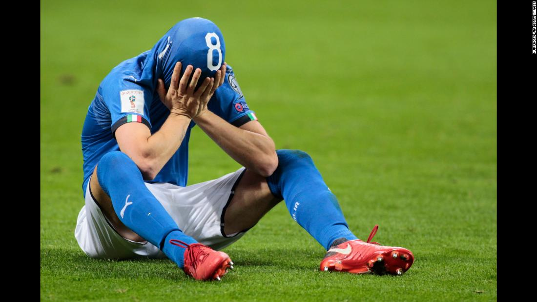 Alessandro Florenzi covers his face after Italy lost its World Cup playoff to Sweden on Monday, November 13. For the first time since 1958, Italy will not be appearing at the World Cup.