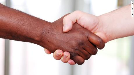 Shaking hands, black and white in the office; Shutterstock ID 41292409; Job: -