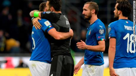 Italians Andrea Barzagli, Gianluigi Buffon, Giorgio Chiellini and Marco Parolo console each other after defeat by Sweden