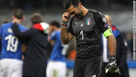 Buffon cries after Italy is eliminated from the World Cup qualifiers by a 1-0 aggregate win by Sweden.