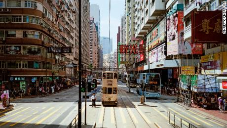 "Sounds of Hong Kong: ""I work with an audio-visual magazine called Maekan, and we wanted to create a sound journey through various cities, going around and capturing sounds and producing a track of them. We wanted some visuals to go with it, so this was on a full day of shooting. We took the tram from one end of Hong Kong Island to the other. From the top of the tram, we stopped and I wanted to capture the street scene below, especially the policeman in the light."""