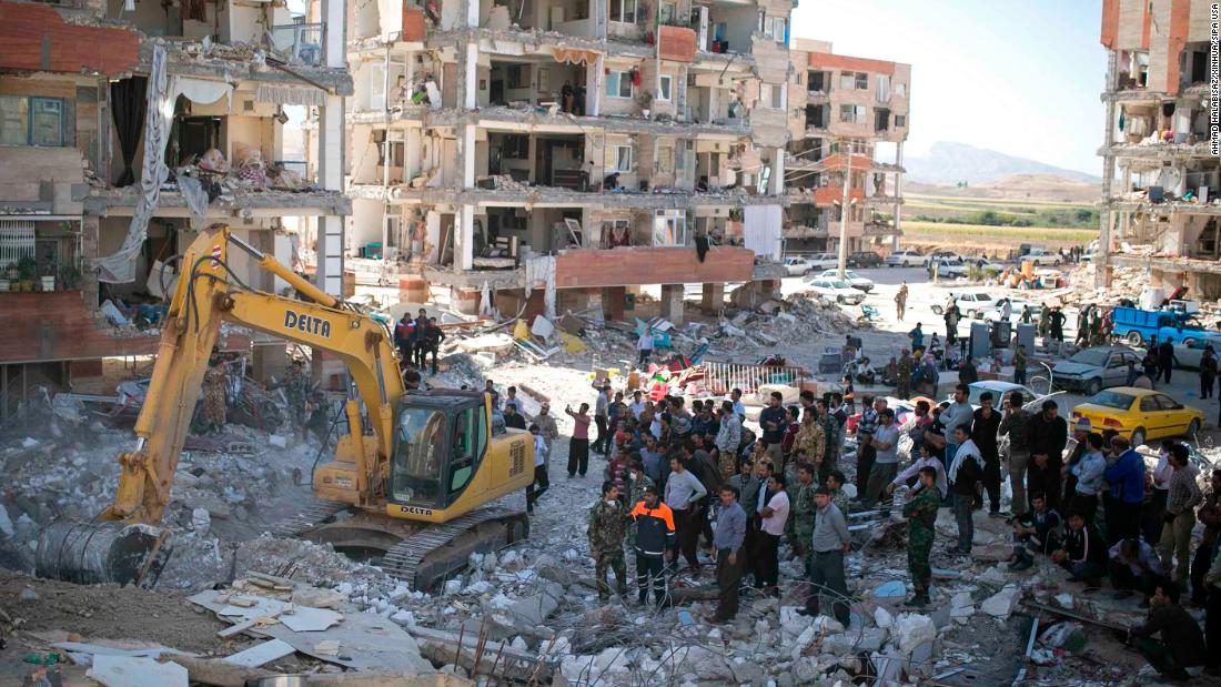 Rescuers use machinery to search for survivors in Sarpol-e Zahab on November 14.