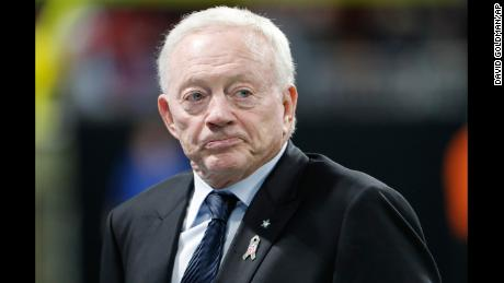 Atlanta Falcons owner Jerry Jones walks the turf inside Mercedes-Benz stadium before the first half of an NFL football game between the Atlanta Falcons and the Dallas Cowboys, Sunday, Nov. 12, 2017, in Atlanta. (AP Photo/David Goldman)