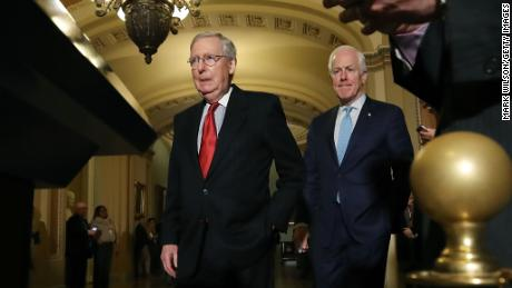 Senate Majority Leader Mitch McConnell (R-KY),(L), and Sen. John Cornyn (R-TX), walk up to speak to reporters about the proposed Senate Republican tax bill, after attending the Senate GOP policy luncheon, at US Capitol on November 14, 2017 in Washington, DC.