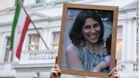 Supporters hold a photo of Nazanin Zaghari-Ratcliffe during a vigil.