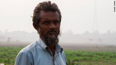"""Where can we go? It's people like us that suffer,"" says Mohammed Najeeb, a small scale farmer who lives in a slum along the banks of the Yamuna River."
