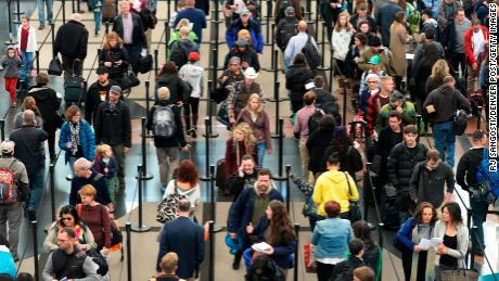 DENVER, CO - NOVEMBER 26: Security lines at  Denver International Airport are long but moving fast, November 26, 2014. The airport was busy with  thanksgiving travelers. (Photo by RJ Sangosti/The Denver Post via Getty Images)