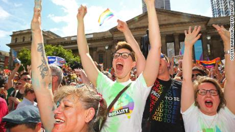 Crowds cheer as the result of the same-sex marriage survey is announced in Melbourne, November 15.