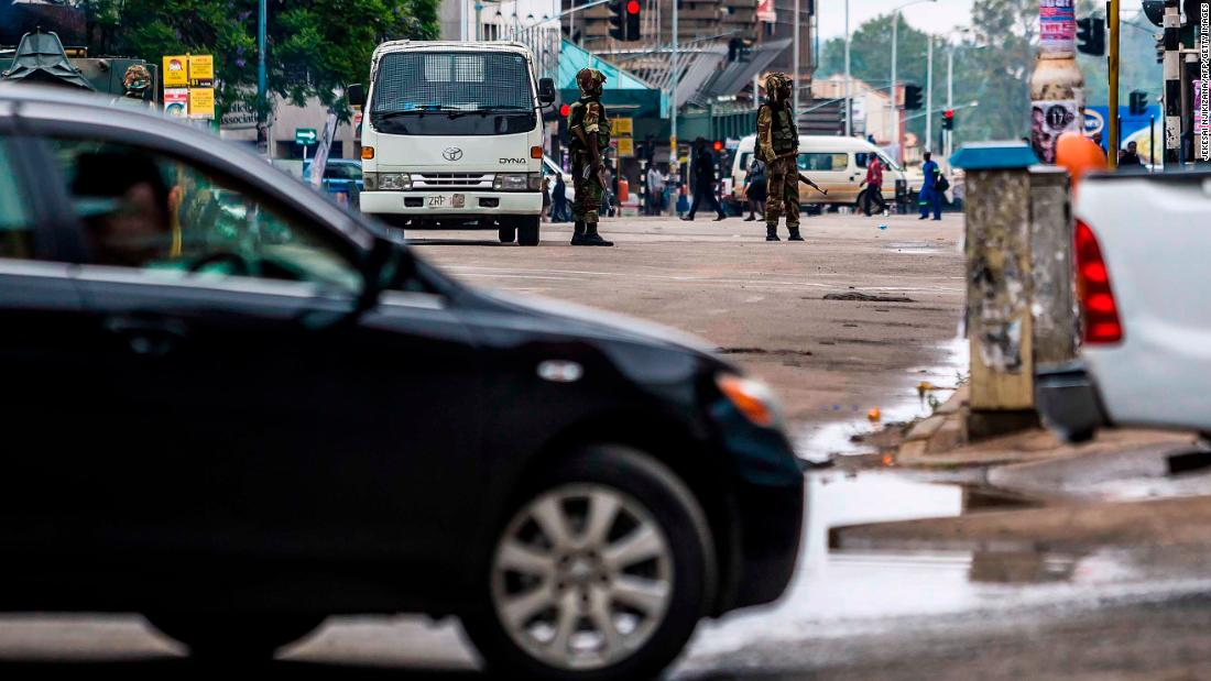 Soldiers monitor traffic in Harare on November 15 as the military set up checkpoints at key locations in the city.