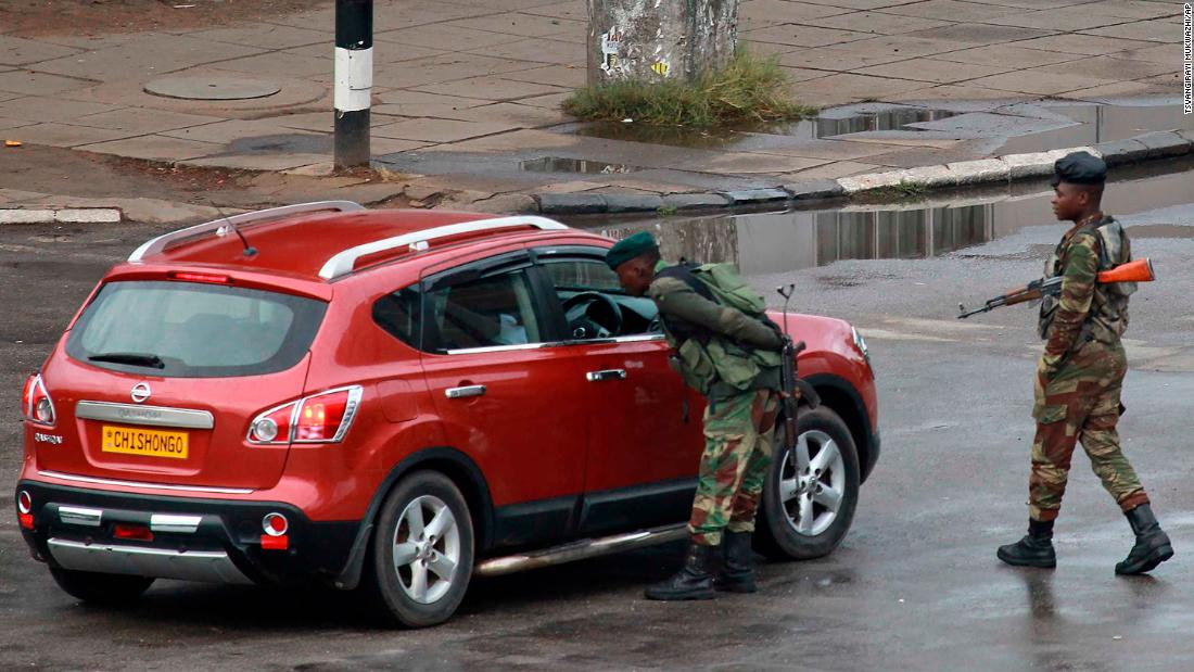 Soldiers inspect a vehicle on a road leading to Mugabe's office in Harare on November 15. The military intervention came after weeks of political turmoil in which Mugabe had sacked his powerful vice president.