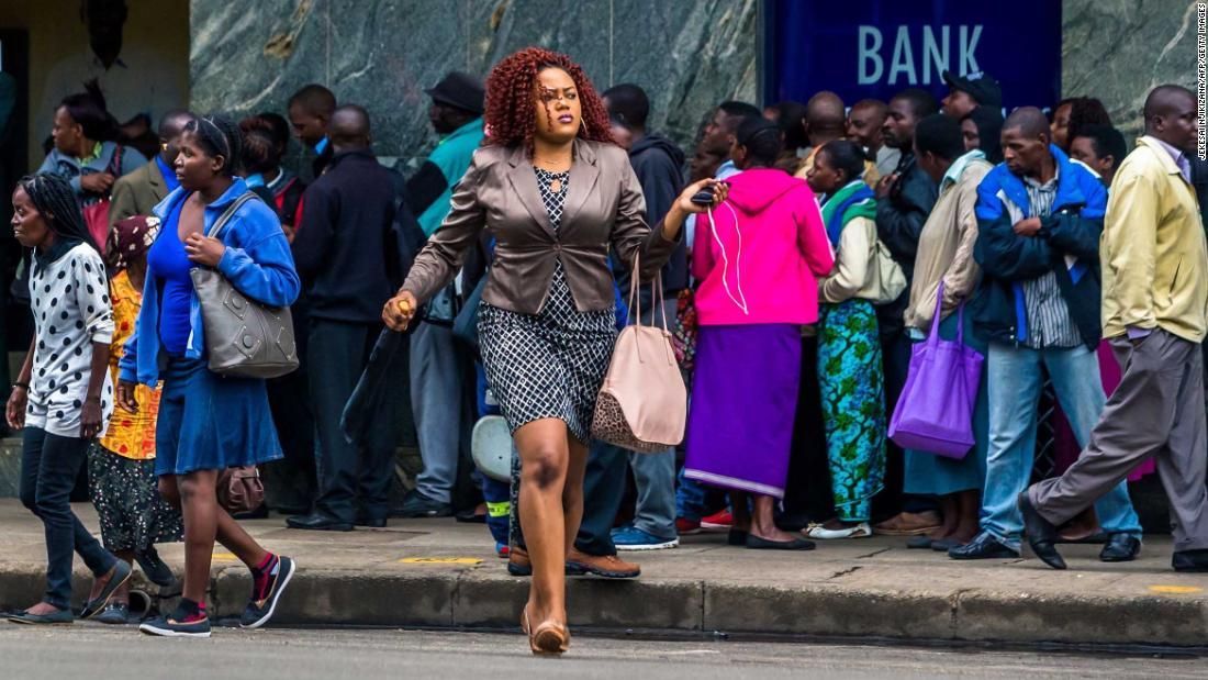 Residents in Zimbabwe's capital line up to withdraw money from the bank on November 15.