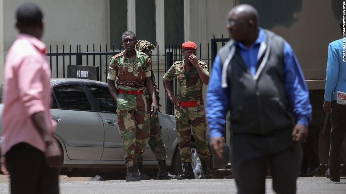 Soldiers seal off a main road to the parliament building in Harare on November 15.