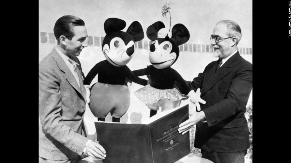 Walt Disney showcases Mickey Mouse.