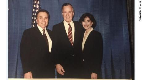 "This image provided to CNN by the ""Michigan woman"" shows former President George H.W. Bush with the woman at a 1992 fundraiser."