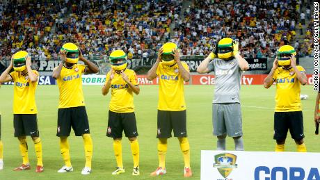 Corinthians football team wear replicas of Senna's helmet on the eve of the 20th anniversary of his death