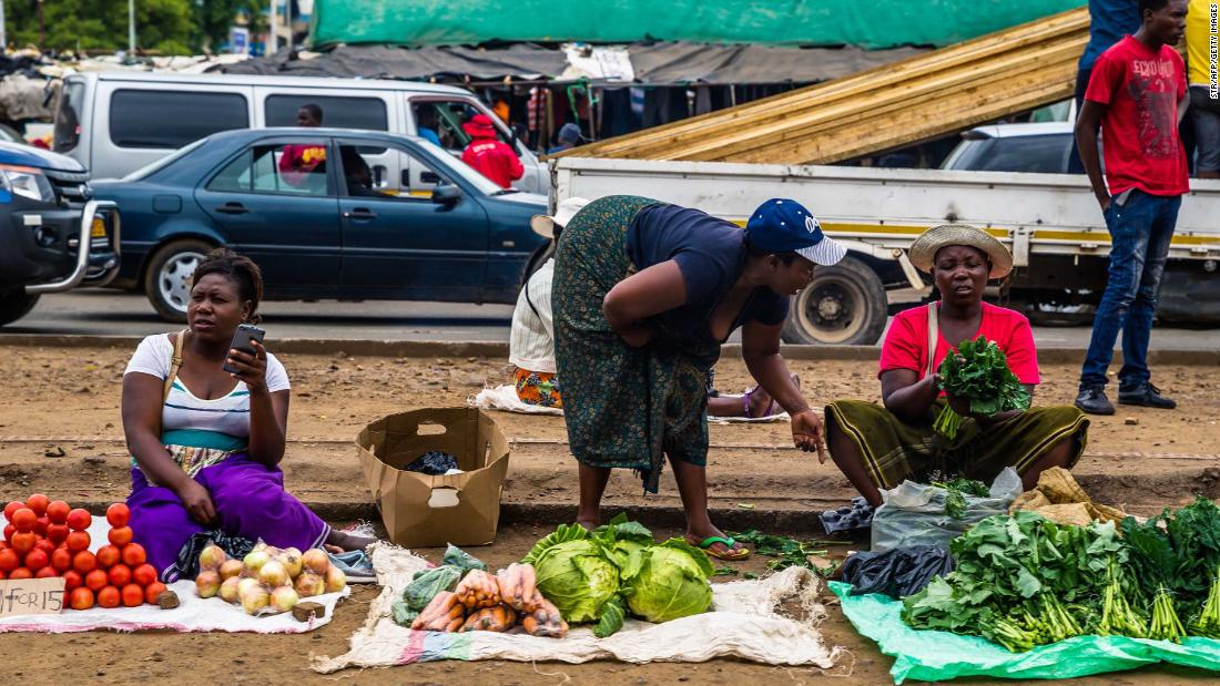 Business continues as usual in Harare as roadside vendors sell vegetables November 16.