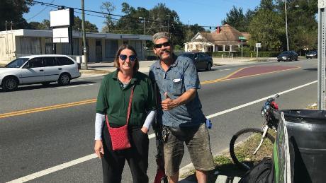 Shannon Lee and Carlo Troche wait at the bus stop in southeast Seminole Heights in Florida.