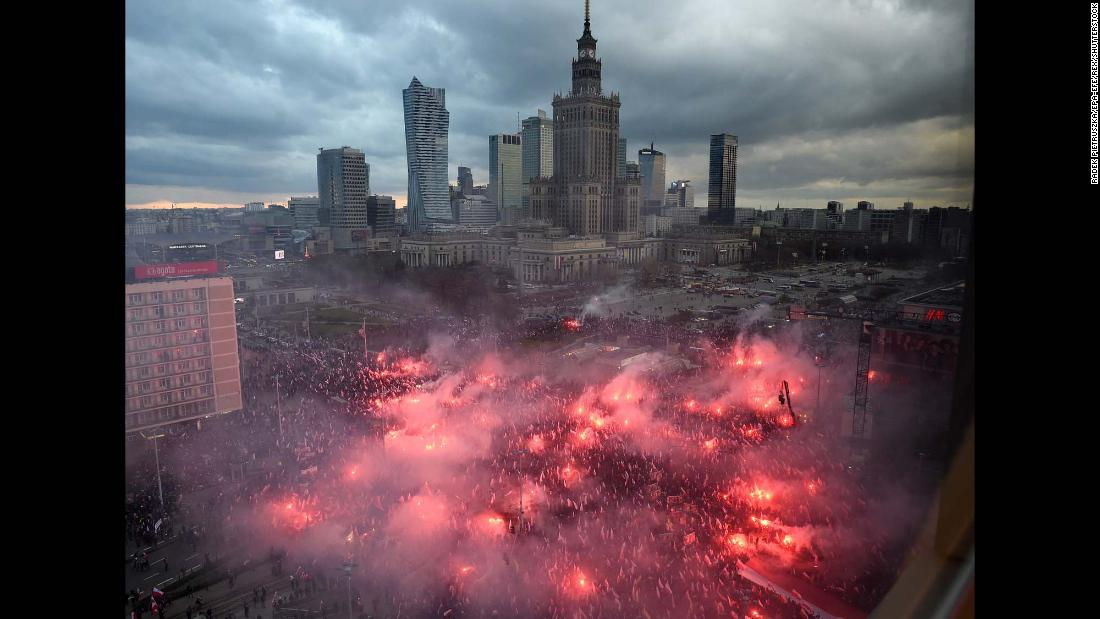 "Nationalist protesters burn flares <a href=""http://www.cnn.com/2017/11/12/europe/poland-warsaw-nationalist-march/index.html"" target=""_blank"">as they disrupt Independence Day celebrations</a> in Warsaw, Poland, on Saturday, November 11. Demonstrators wore masks and waved Polish flags, chanting ""Death to enemies of the homeland"" and ""Catholic Poland, not secular."""