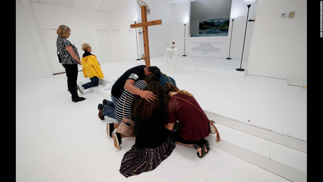 "People pray in the First Baptist Church of Sutherland Springs, Texas, which was <a href=""http://www.cnn.com/2017/11/13/us/inside-first-baptist-church/index.html"" target=""_blank"">opened up as a memorial</a> on Sunday, November 12. Earlier this month, 25 people and an unborn child were killed in a shooting attack at the church."
