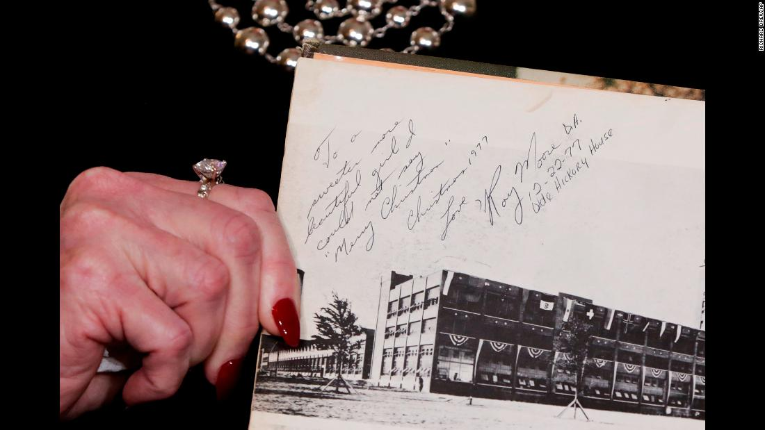 "Beverly Young Nelson shows an inscription in her high school yearbook Monday, November 13, during <a href=""http://www.cnn.com/2017/11/13/politics/gloria-allred-roy-moore-alabama/index.html"" target=""_blank"">a news conference in which she accused Roy Moore,</a> a US Senate candidate, of sexually assaulting her when she was a teenager. Moore called the accusation ""absolutely false"" in a statement, denying that he knew Nelson. Nelson's accusations came after The Washington Post published <a href=""https://www.washingtonpost.com/investigations/woman-says-roy-moore-initiated-sexual-encounter-when-she-was-14-he-was-32/2017/11/09/1f495878-c293-11e7-afe9-4f60b5a6c4a0_story.html"" target=""_blank"">a bombshell report</a> that said Moore pursued relationships with teenage women while he was in his 30s. One woman said she was 14 years old when Moore initiated sexual contact with her. Moore has denied the allegations in the report."